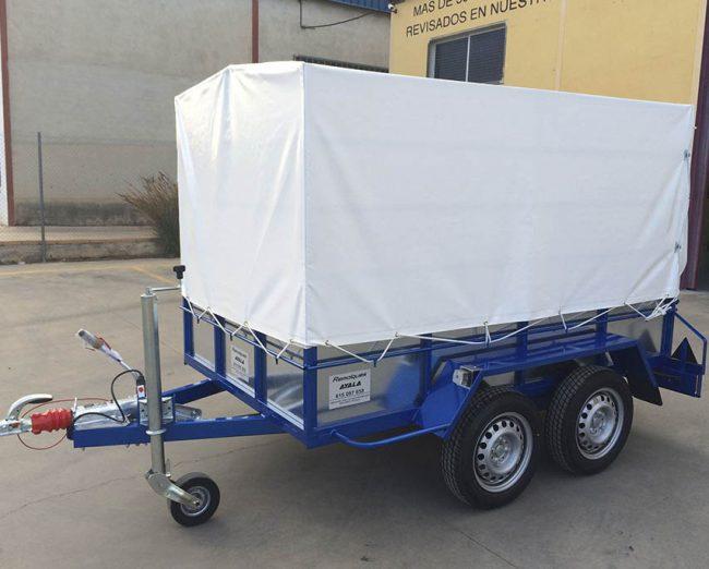 Remolque 2 ejes + freno de inercia + lona y arquillos 2.400 x 1.400 x 1.500 -mma 750 kg-